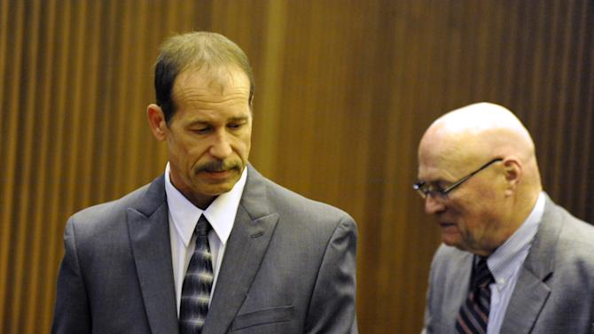Theodore Wafer stands in court during his trial before Judge Dana Hathaway at Frank Murphy Hall of Justice in Detroit on Thursday, July 24, 2014. The 55-year-old Wafer is charged with second-degree murder in the death of 19-year-old Renisha McBride. He claims it was an act of self-defense. (AP Photo/Detroit News, David Coates) DETROIT FREE PRESS OUT; HUFFINGTON POST OUT