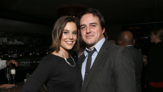 Ashley Williams and husband Neal Dodson attend the DETAILS Hollywood Mavericks Party on Thursday, Nov. 29, 2012 in Los Angeles. (Photo by Todd Williamson/Invision for Details Magazine/AP Images)