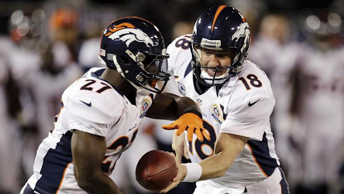 Denver Broncos quarterback Peyton Manning (18) hands off to running back Knowshon Moreno during the first quarter of an NFL football game against the Oakland Raiders in Oakland, Calif., Thursday, Dec. 6, 2012. (AP Photo/Ben Margot)