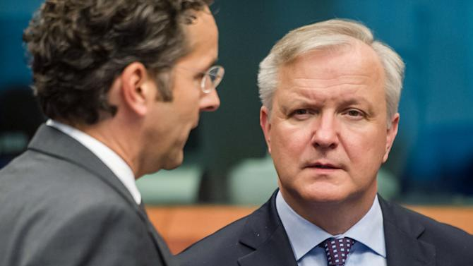 European Commissioner for Economic and Monetary Affairs Olli Rehn, right, talks with Eurogroup President Jeroen Dijsselbloem at the start of an Eurogroup meeting at the EU Council in Brussels on Monday, May 13, 2013. (AP Photo/Geert Vanden Wijngaert)
