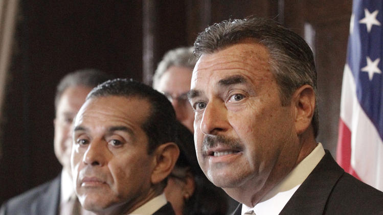 Los Angeles Police Chief Charlie Beck, right, and Mayor Antonio Villaraigosa discuss the dismissal of the 2001 LAPD consent decree, ending federal oversight of the department prompted by the Rampart corruption scandal, at police headquarters on Thursday, May 16, 2013, in Los Angeles. (AP Photo/Reed Saxon).
