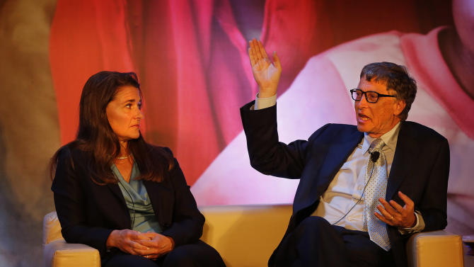 Bill and Melinda Gates talk to Indian writer Chetan Bhagat, unseen, in New Delhi, India, Thursday, Sept. 18, 2014. The interaction was organized by the Bill and Melinda Gates foundation. (AP Photo /Manish Swarup)