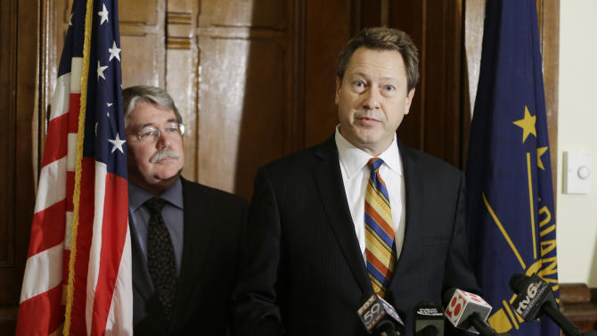 Indiana Attorney General Greg Zoeller, left, listens as Bill Baten speaks during a  news conference at the Statehouse Thursday, Dec. 20, 2012, in Indianapolis. Zoeller announced the details of the distribution of the $6 million in supplemental relief to victims of the Indiana State Fair stage collapse. (AP Photo/Darron Cummings)