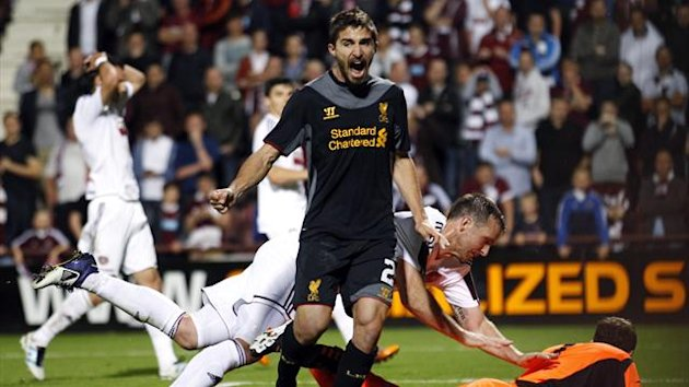 Liverpool's Fabio Borini (C) reacts after they scored against Hearts during their Europa League soccer match at Tynecastle stadium in Edinburgh, Scotland August 23, 2012 (Reuters)
