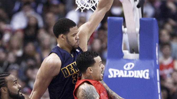 Los Angeles Clippers forward Matt Barnes, right, goes to lay up the ball as Denver Nuggets' JaVale McGee (34) defends and Clippers' Ronny Turiaf of France looks on during the first half of their NBA basketball game, Tuesday, Dec. 25, 2012, in Los Angeles. (AP Photo/Jason Redmond)