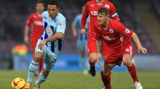 Coventry City's Jordan Clarke turns away from Crawley Town's Kyle McFadzean