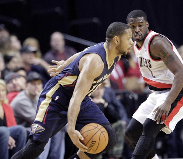 New Orleans Pelicans guard Eric Gordon, left, drives on Portland Trail Blazers guard Wesley Matthews during the first half of an NBA basketball game in Portland, Ore., Saturday, Dec. 21, 2013