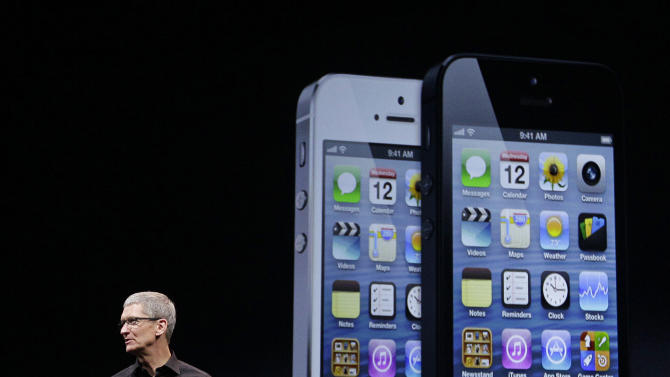 Apple CEO Tim Cook talks on stage during the introduction of the new iPhone 5 in San Francisco, Wednesday, Sept. 12, 2012.  (AP Photo/Eric Risberg)