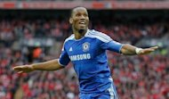 Chelsea and Ivory Coast idol Didier Drogba (pictured in May) Wednesday said he had signed a two-and-a-half-year deal with Chinese club Shanghai Shenhua, where he will join former team-mate Nicolas Anelka