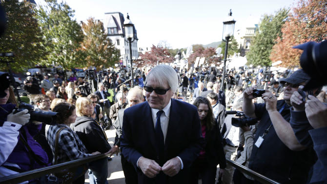 Pennsylvania senior Deputy Attorney Gen. Joseph E. McGettigan III, center, walks away after speaking with members of the media outside the Centre County Courthouse in Bellefonte, Pa., Tuesday, Oct. 9, 2012. Former Penn State University assistant football coach Jerry Sandusky was sentenced to at least 30 years in prison, effectively a life sentence, in the child sexual abuse scandal that brought shame to Penn State and led to coach Joe Paterno's downfall. (AP Photo/Matt Rourke)