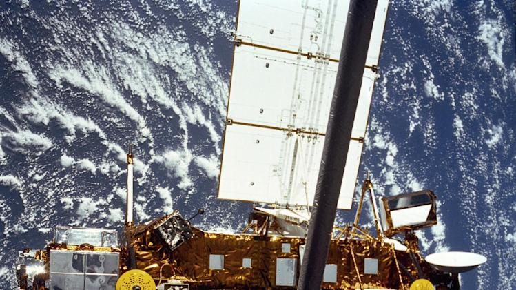 In this image provided by NASA this is the STS-48 onboard photo of the Upper Atmosphere Research Satellite (UARS) in the grasp of the RMS (Remote Manipulator System) during deployment, from the shuttle in September 1991. The satellite is 35 feet long, 15 feet in diameter, weighs 13,000 pounds. U.S. space officials say they expect a dead satellite to fall to Earth in about a week. NASA has been watching the 6-ton satellite closely. NASA scientists are doing their best to tell us where a plummeting 6-ton satellite will fall later this week. It's just that if they're off a little bit, it could mean the difference between hitting Florida or New York. Or, say, Iran or India. (AP Photo/NASA)