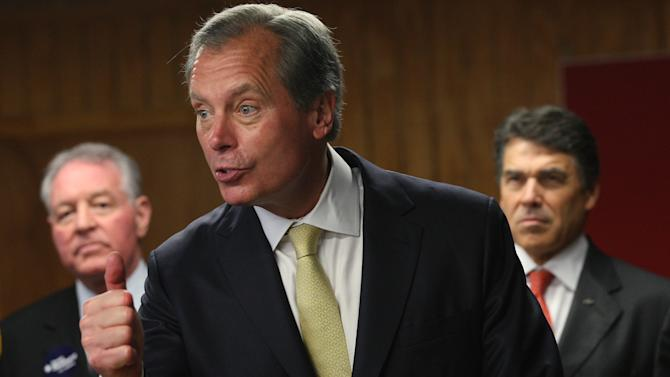 Texas Lt. Gov. David Dewhurst addresses the media during a campaign stop at the VFW Post 76 in San Antonio, Monday, July 30, 2012. Dewhurst was courting the veteran's vote on the last day before the U.S. Senate runoff election with Tea Party candidate Ted Cruz. Backing Dewhurst were San Antonio Spurs owner Peter Holt, left, and Gov. Rick Perry.  (AP Photo/San Antonio Express-News, Jerry Lara) MAGS OUT NO SALES  SAN ANTONIO OUT
