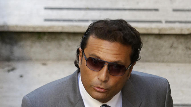 FILE - This Jan. 13, 2012 file photo shows former captain of the Costa Concordia luxury cruise ship Francesco Schettino arriving at the Teatro Moderno theater for the second hearing of a trial for the Jan. 13, 2012 shipwreck in which 32 people died, in Grosseto, Italy. An Italian prosecutor on Monday, Feb. 25, 2013 formally requested a manslaughter indictment against the captain of the Costa Concordia, which crashed into a reef off Tuscany last year, killing 32 people. The prosecutors' office in Grosseto, Tuscany, also wants Francesco Schettino, the captain of the luxury cruise liner, to be tried for causing a shipwreck and abandoning ship while the frantic evacuation of passengers and crew was still being conducted. (AP Photo/Gregorio Borgia, files)