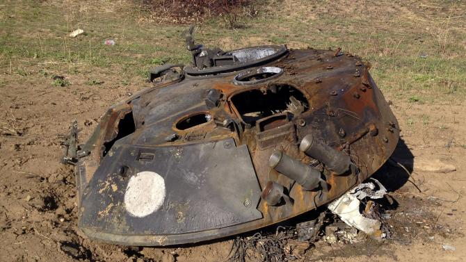 A painted white circle marks the turret of a BMP-2 armored personnel carrier on a battlefield near Starobesheve