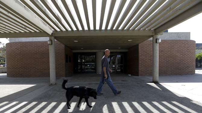 In this photo taken Oct. 6, 2012, Don Matyja, a homeless Army veteran walks his dog Tyson at Lions park in Costa Mesa, Calif. The posh California coastal town recently passed a law banning patrons from lounging on furniture in its public libraries, having poor personal hygiene or emitting an odor bothers others. The ordinances are the latest in a rash of law-making in Orange County cities that some see as thinly veiled attacks on the homeless. But lawmakers defend the policies as necessary to ensure safety, protect public property and guarantee access to communal spaces. (AP Photo/Chris Carlson)