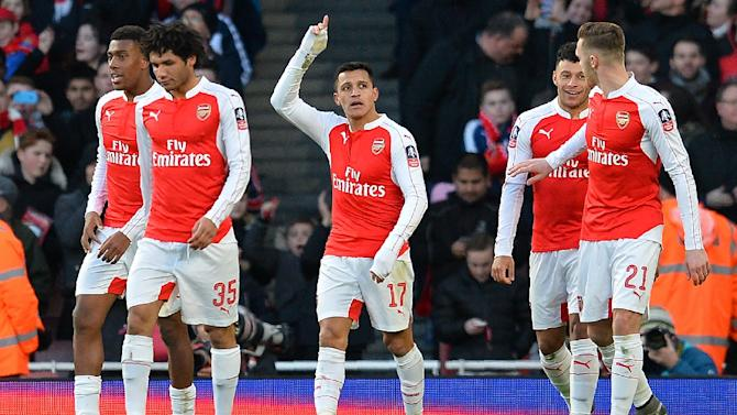 Arsenal's forward Alexi Sanchez C) celebrates scoring his team's second goal during the English FA Cup fourth round football match between Arsenal and Burnley at the Emirates stadium in London, on January 30, 2016