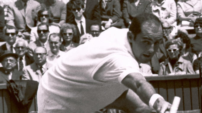 FILE - In this June 26, 1965 file photo Bob Hewitt competes during a tennis match at Wimbledon, England. Tennis great Bob Hewitt has been charged with two counts of rape and one count of sexual assault of minors — nearly 20 years after the last of the alleged offenses is said to have occurred. Prosecutors on Friday Aug. 16, 2013, charged the multiple Grand Slam doubles champion with raping a girl under the age of 16 in 1981 in Sun City in northern South Africa. Hewitt also was charged with raping another girl under 16 in Boksburg, a city east of Johannesburg, in 1982. (AP Photo, File)