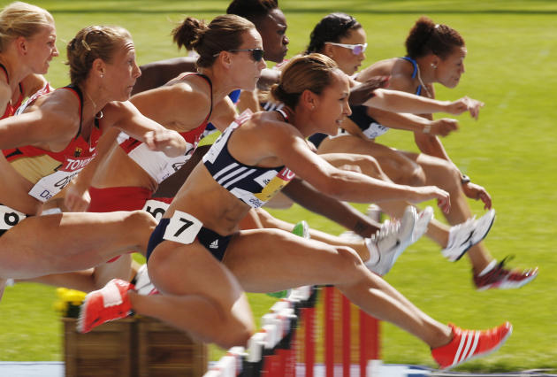 Britain's Jessica Ennis, front, clears a hurdle in the Heptathlon 100m hurdles at the World Athletics Championships in Daegu, South Korea, Monday, Aug. 29, 2011. (AP Photo/Kin Cheung)