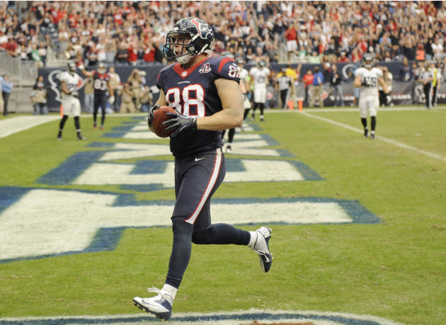 Houston Texans' Garrett Graham (88) scores a touchdown against the Jacksonville Jaguars during the fourth quarter of an NFL football game Sunday, Nov. 18, 2012, in Houston. The Texans won in overtime 