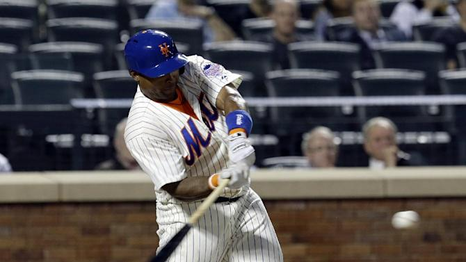 New York Mets' Marlon Byrd hits a three-run home run during the third inning of the baseball game against the Cincinnati Reds at Citi Field Monday, May 20, 2013 in New York. (AP Photo/Seth Wenig)