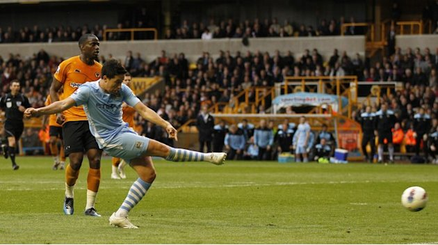 Manchester City's French  Samir Nasri Scores His Goal 