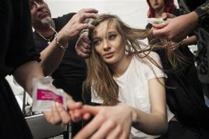 A model is made up before the BCBG Max Azria Fall 2014 collection during New York Fashion Week