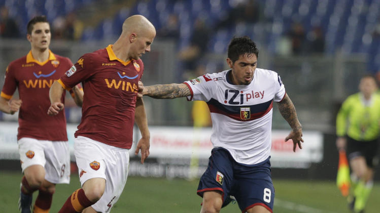 AS Roma U.S. midfielder Michael Bradley, left, and Genoa forward Juuan Manuel Vargas, of Peru, fight for the ball during a Serie A soccer match between As Roma and Genoa, in Rome's Olympic stadium, Sunday, March 3, 2013. (AP Photo/Andrew Medichini)