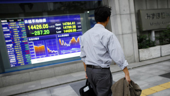 Asian stocks down after weak US earnings