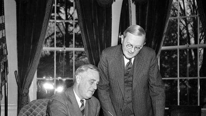 FILE - In this April 2, 1940 file photo, William L. Austin, director of the U.S. Census Bureau, right, helps President Franklin D. Roosevelt fill out the large form at the White House in Washington. Veiled in secrecy for 72 years because of privacy protections, the 1940 U.S. Census is the first historical federal decennial survey to be made available on the Internet initially rather than on microfilm. (AP Photo)
