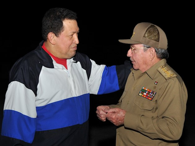 In this picture provided Tuesday, Dec. 11, 2012 by Cuba&#39;s state newspaper Granma, Cuba&#39;s President Raul Castro, right, receives Venezuela&#39;s President Hugo Chavez at the Jose Marti International airport in Havana, Cuba, Monday, Dec. 10, 2012. Chavez arrived in Cuba on Monday for a fourth cancer-related operation after designating the vice president as his political heir. (AP Photo/Granma)