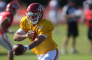 Kansas City Chiefs quarterback Aaron Murray hands off the ball during an NFL football training camp Monday, July 28, 2014, on the Missouri Western State University campus in St. Joseph, Mo. (AP Photo/The St. Joseph News-Press, Todd Weddle)