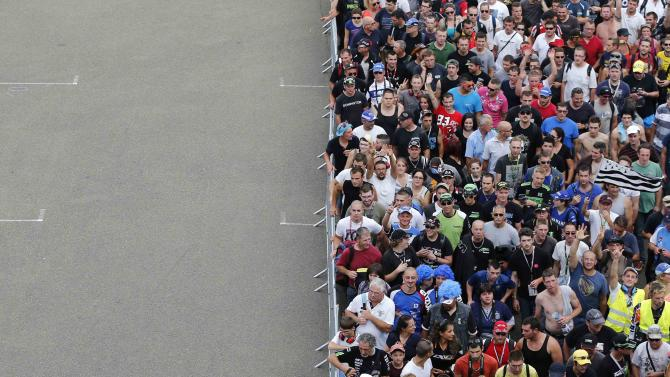 People arrive in the stands ahead of the 37th Le Mans 24 Hours motorcycle endurance race in Le Mans