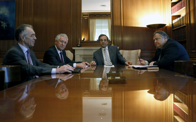 New Greek Prime Minister Antonis Samaras, center, during his meeting with the heads of his two minority coalition partners, Evangelos Venizelos from the Greek Socialist PASOK party, right, and the smaller Democratic Left&#39;s Fotis Kouvelis, 2nd left, and banker Vassilis Rapanos, left, in Athens, Thursday, June 21 2012. Samaras is set to announce his cabinet Thursday, a day after brokering a three-party governing coalition that ends weeks of political uncertainty in the crisis-afflicted country.All three coalition parties have promised to broadly respect Greece&#39;s pledges to undertake further harsh austerity measures and reforms, conditions demanded by European partners and the International Monetary Fund in return for more bailout loans.(AP Photo/Kostas Tsironis)