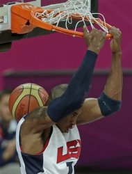 United States' Kobe Bryant dunks the ball during a men's basketball game against Nigeria at the 2012 Summer Olympics, Thursday, Aug. 2, 2012, in London. (AP Photo/Charlie Riedel)