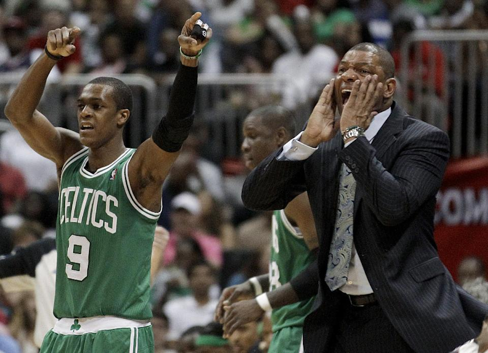 Boston Celtics coach Doc Rivers, right, yells from the sidelines, next to Rajon Rondo, left, during the third quarter of Game 1 of an opening-round NBA basketball playoff series against the Atlanta Hawks, Sunday, April 29, 2012, in Atlanta. Atlanta won 83-74. (AP Photo/David Goldman)