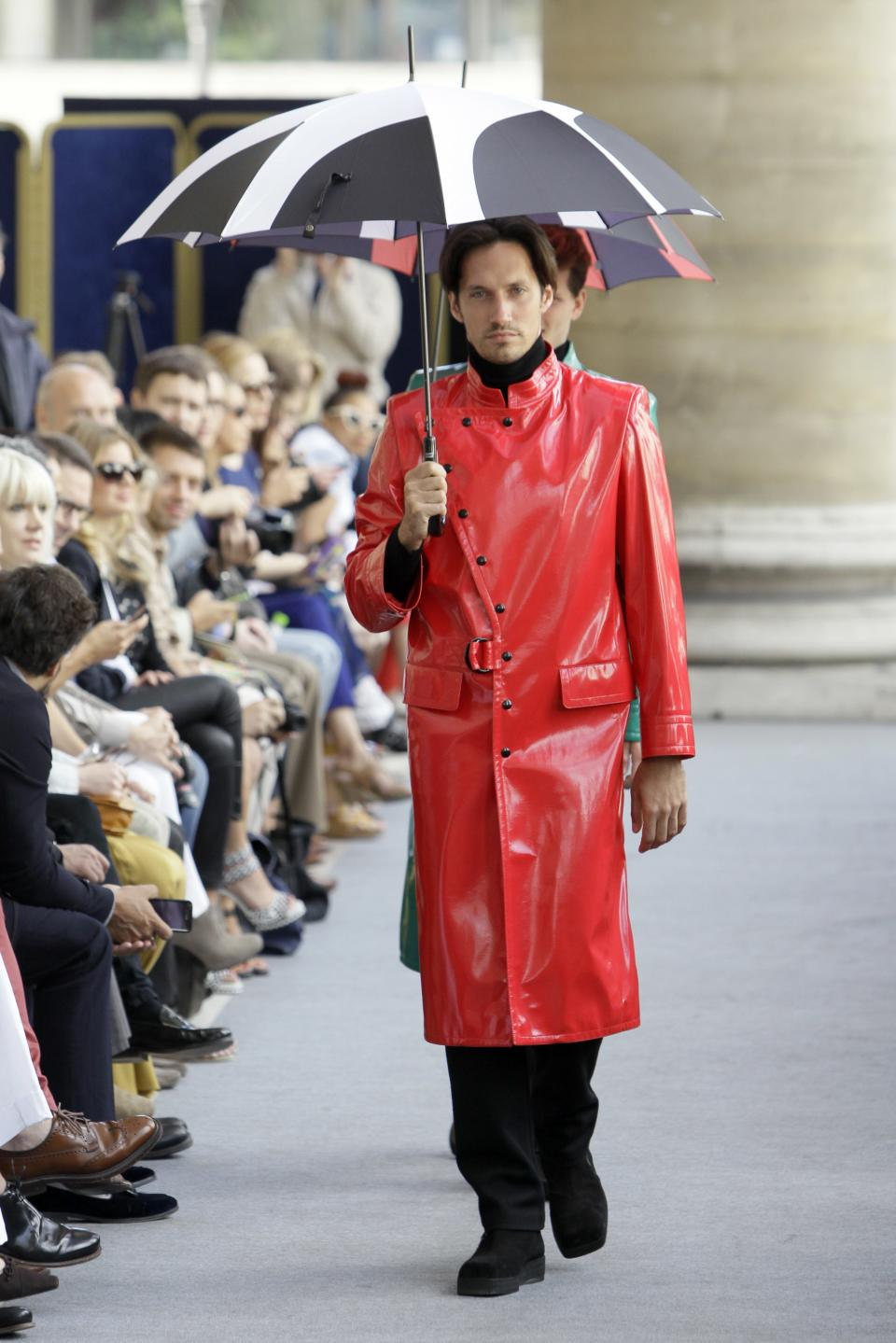 A model wears a creation by French fashion designer Pierre Cardin as part of his Men's Spring-Summer 2013 collection, for the Paris Fashion Week, in Paris, France, Sunday, July 1, 2012. (AP Photo/Francois Mori)