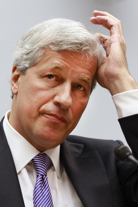 FILE- In this Tuesday, June 19, 2012, file photo, Jamie Dimon, CEO of JPMorgan Chase, testifies before the House Financial Services Committee on Capitol Hill in Washington. JPMorgan Chase said Wednesd
