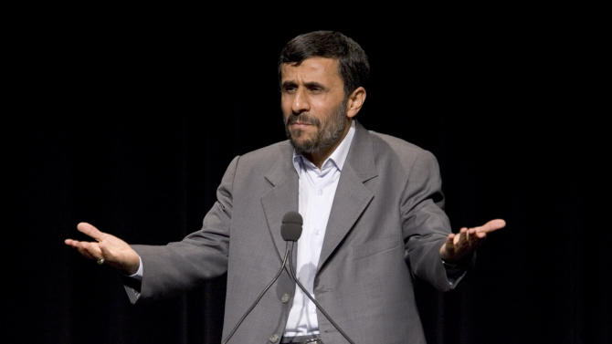 FILE - In this Sept. 24, 2007 file photo, Iranian President Mahmoud Ahmadinejad speaks at Columbia University in New York. As Ahmadinejad's successor Hasan Rouhani prepares to address the United Nations for the first time on Tuesday, he has already made a deep impression on world leaders with his markedly milder tone and apparent willingness to reopen negotiations with the West on Iran's disputed nuclear program. In contrast, Ahmadinejad was jeered and pilloried during his eight visits to U.N. headquarters in New York. (AP Photo/Stephen Chernin, File)