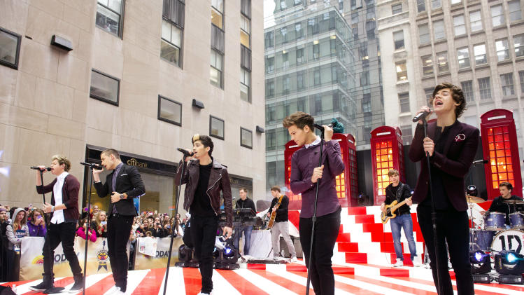 "One Direction members, from left, Niall Horan, Liam Payne, Zayn Malik, Louis Tomlinson and Harry Styles perform on NBC's ""Today"" show on Tuesday, Nov. 13, 2012 in New York. (Photo by Charles Sykes/Invision/AP)"