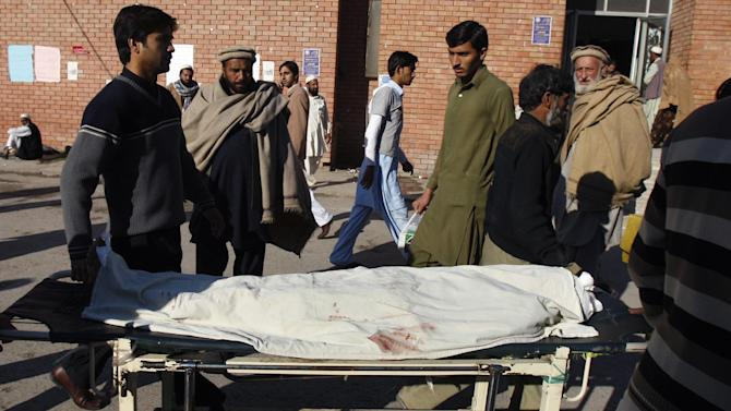 Pakistani relatives transport the dead body of a female polio worker who was killed by gunmen at a local hospital in Peshawar, Pakistan, Tuesday, Dec. 18, 2012. Gunmen killed several people working on a government polio vaccination campaign in two different Pakistani cities on Tuesday, officials said. The attacks were likely an attempt by the Taliban to counter an initiative the militant group has long opposed. (AP Photo/Mohammad Sajjad)