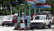 Cars queue up to fill tanks at a government-run petrol station in down town Yangon in 2007. Myanmar has signed a raft of oil exploration deals with foreign companies, state media reported Wednesday, as the reformist government seeks overseas investment to spur economic development