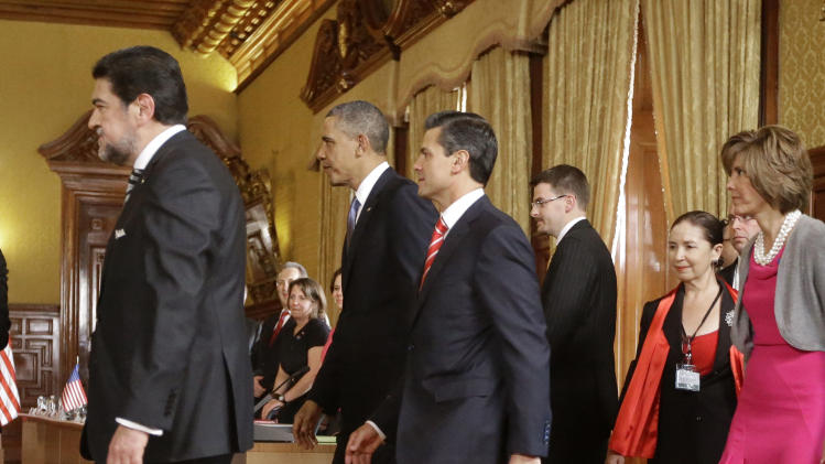 President Barack Obama and Mexico's President Enrique Pena Nieto, right, arrive for their bilateral meeting at the Palacio Nacional, Salon de Recepciones in Mexico City, Thursday, May 2, 2013. (AP Photo/Pablo Martinez Monsivais)
