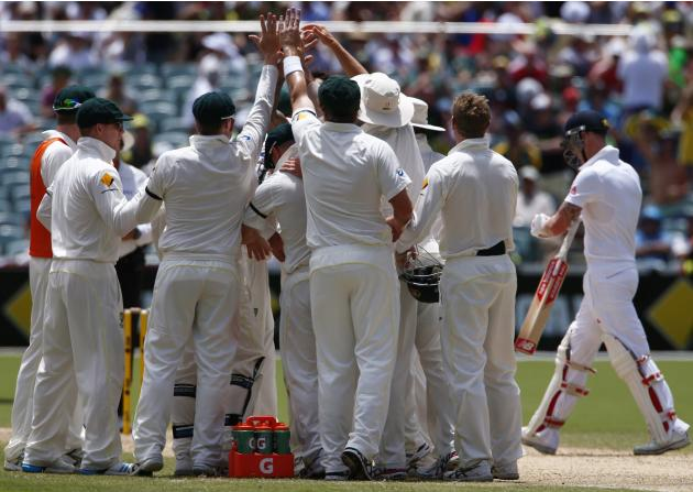 Australia's players celebrate after taking the wicket of England's Stokes during the third day of the second Ashes test cricket match in Adelaide