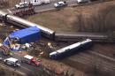 FILE - In this file frame grab from video provided by WTVD-11, on March 9, 2015, authorities respond to a collision between an Amtrak passenger train and a truck in Halifax County, N.C. An AP review of news coverage shows there were at least 20 collisions between trains and tractor trailers in 2013 and 2014 after truck drivers drove into the path of oncoming trains or got stuck. The nation's railroads want Congress to give them five more years to implement a more than $15 billion high-tech solution for train wrecks. (AP Photo/WTVD-11, File)