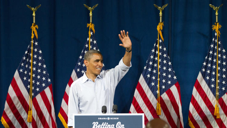 President Barack Obama waves at Dobbins Elementary School in Poland, Ohio, Friday,  July 6, 2012, during his Betting On America campaign tour.  (AP Photo / Scott R. Galvin)