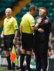 St Johnstone manager Steve Lomas argues with referee Iain Brines at Celtic Park
