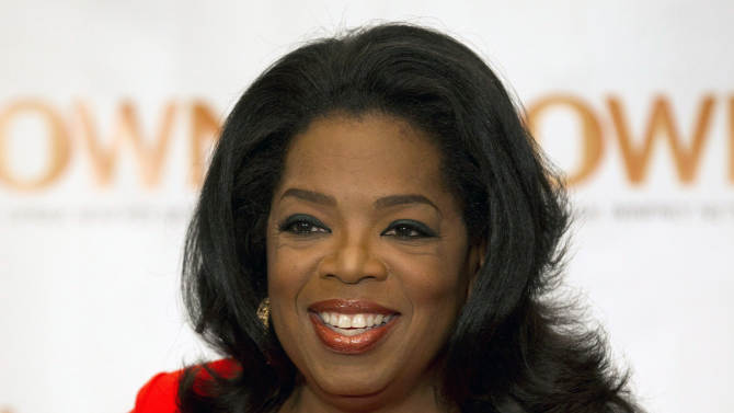 """FILE - This April 16, 2012 file photo shows Oprah Winfrey in Toronto. Winfrey announced Wednesday, Dec. 5, that she has chosen a debut novel for her book club, """"The Twelve Tribes of Hattie,"""" by Ayana Mathis. An author interview will be aired Feb. 3, 2013 on Winfrey's OWN network. (AP Photo/The Canadian Press, Frank Gunn, file)"""