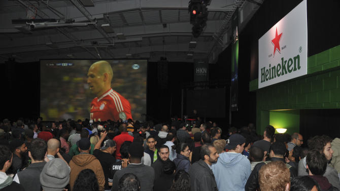 IMAGE DISTRIBUTED FOR HEINEKEN - Fans attend Heineken's epic viewing party of the UEFA Champions League Final on Saturday, May 25, 2013 in New York. (Photo by Charles Sykes/Invision for Heineken/AP Images)