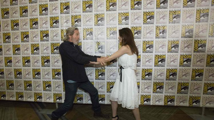 "Cast members Bridges and Rush pose at a press line for the movie ""The Giver"" during the 2014 Comic-Con International Convention in San Diego"
