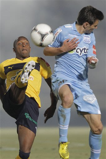 Romania Romeo Sourtou, right, of Apollon, fights for the ball with Portugal Carlito Soares of AEL Limassol during their final cup soccer match at Tsirion stadium in southern port city of Limassol, Cyp